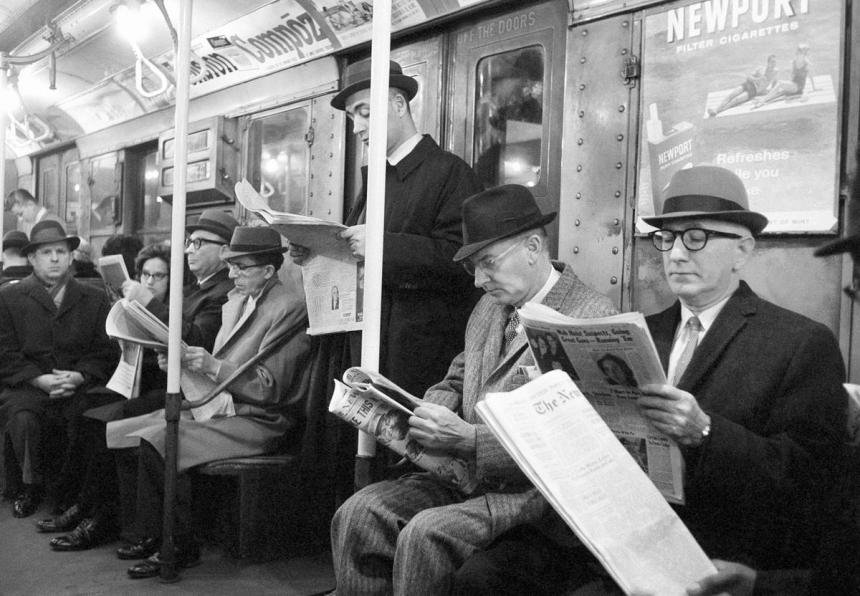 people-read-their-morning-newspapers-on-new-yorks-subway-en-route-to-work-1963